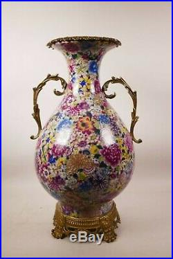 A large Chinese polychrome porcelain vase with ormolu style mounts and handles
